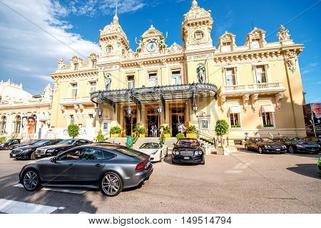 Monte Carlo, Monaco - June 13, 2016: Expensive cars near famous Casino building in Monte Carlo in Monaco. This Casino is a gambling and entertainment complex located in Monaco