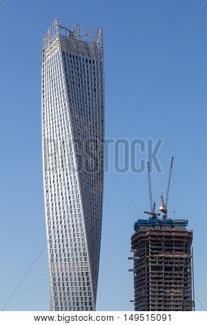 Dubai, United Arab Emirates - October 17, 2014: Two skyscrapers on the artificial city district Dubai Marina