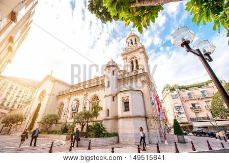 Monte Carlo, Monaco - June 13, 2016: City street view with Saint-Charles cathedral in Monte Carlo in Monaco