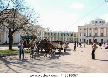 St. Petersburg, Russia - 12 August, People in horses with carts,12 August, 2016. The annual International Festival of Motor Harley Davidson in St. Petersburg Ostrovsky Square.