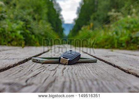 Wooden Health Trail In The Mountain Out Of Focus In The Middle Of A Green Forest With A Smartphone A