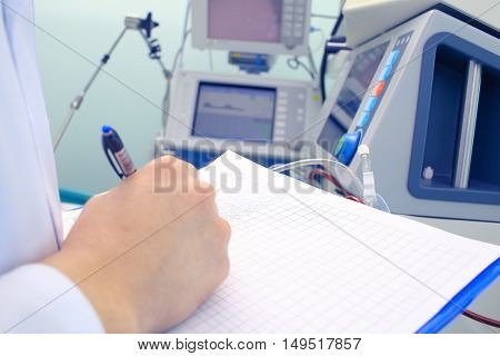 Scientific work with medical equipment. Daily check