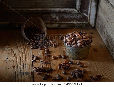 coffee bean, star anise on a wooden background