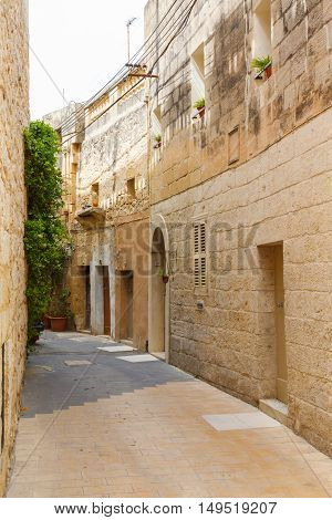 Traditional narrow street in Malta. Maltese architecture in Valletta, Malta