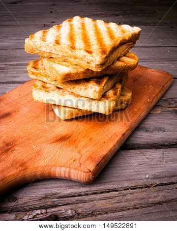 Crispy and hot sandwiches with cheese, grilled