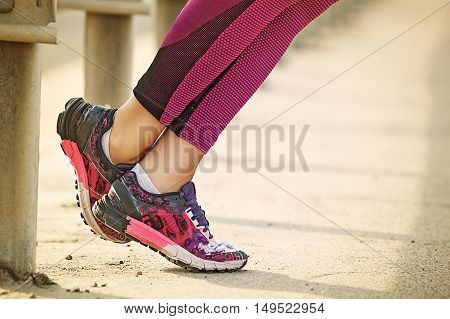 Woman Exercising outdoors. Sneakers. Close up concept.