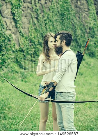 Young Attractive Couple Shoots From The Bow