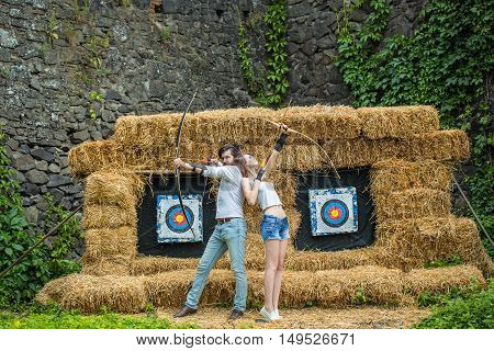 Young Couple With The Bows