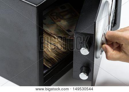 Man's Hand Opening The Door Of A Safe Deposit Box