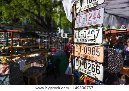 Buenos Aires Argentina - October 6 2013: People in the San Telmo street market in the San Telmo neighborhood in the city of Buenos Aires in Argentina