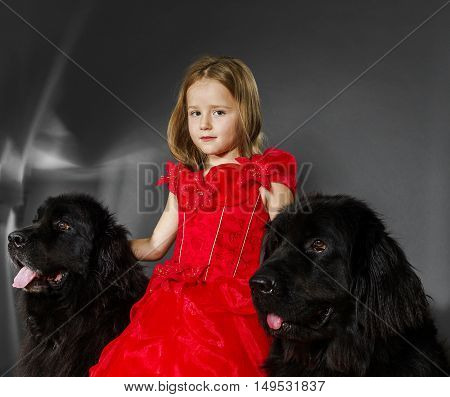 Beauty And The Beast. Girl With Big Black Water-dog.