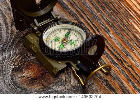 compass on wooden surface