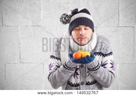 Young man holding natural vitamins in winter
