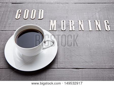 Coffee cup espresso  hot white on wooden board with good morning letters