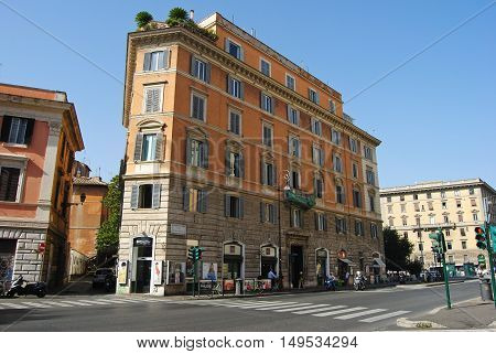 Rome, Italy - October 9, 2014. Building along Corso Vittorio Emanuele avenue in Rome, with commercial properties on the ground floor, surrounding buildings and people.