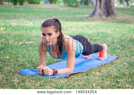 Young Fitness Girl Doing Plank During Training Workout