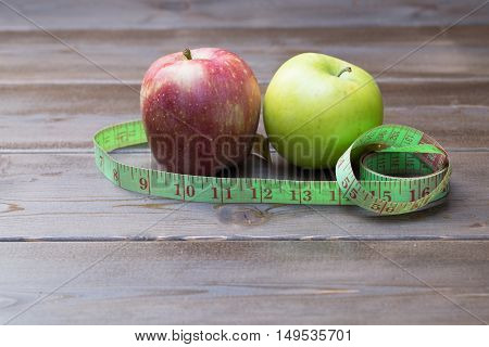 Green And Red Apples Wrapped With Measuring Tape