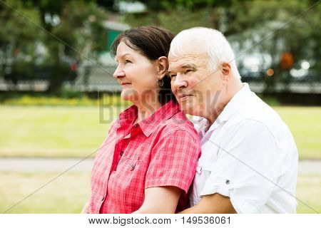 Close-up Of A Loving Senior Couple In Park