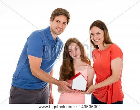 Smiling Family Holding House Model Over White Background