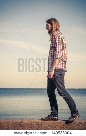 Man Walking Relaxed On Stone Wall By Seaside