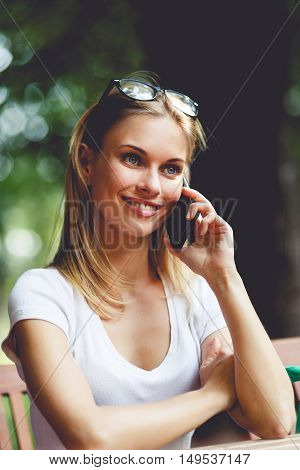 Smiling girl talking on phone in Park outdoors