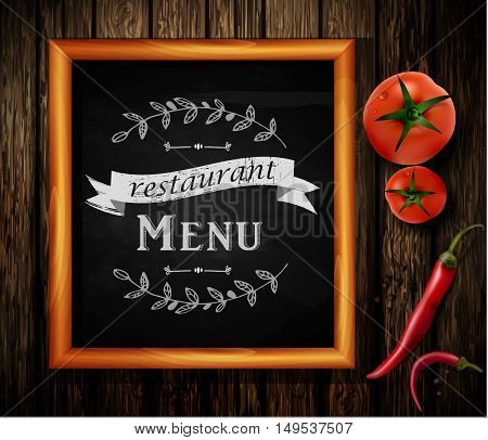 Menu on Chalkboard background with hand drawn ornament for restaurant in wooden frame on wooden background with two tomatos and chili pepper