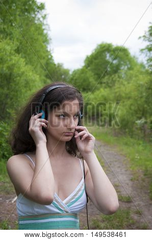 Girl in the forest is in talks with the microphone