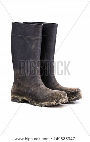Dry dirty Mud boots isolated on pure white background 3/4 view