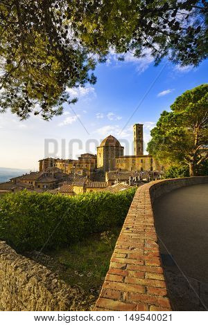 Tuscany Volterra town skyline church and trees on sunset. Maremma Italy Europe