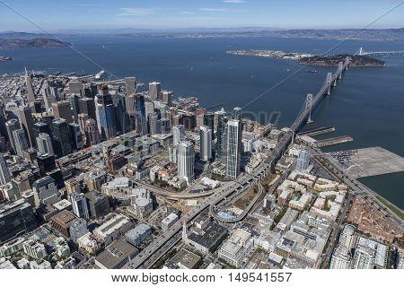 Afternoon aerial view of San Francisco city, bay and bridge towards Oakland, California.