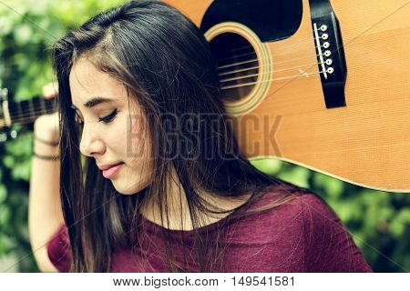 Young Woman Guitar Music Concept