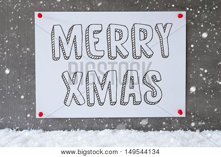 Label With English Text Merry Xmas. Urban And Modern Cement Wall As Background On Snow With Snowflakes.