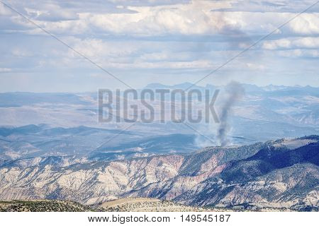smoke plume from controlled forest burn in White RIver National Forest, Rocky Mountains, Colorado