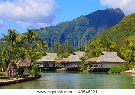 Island of Moorea in the French Polynesia with her exuberant vegetation lagoon bungalows and mountains.