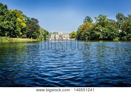 WARSAW, POLAND - SEPTEMBER 27: View of the Lazienki Palace, the Palace on the Water in Lazienki Park or Royal Baths Park in Warsaw, Poland on September 27, 2016