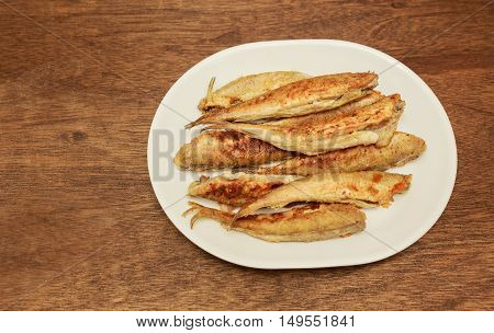 Lot of small fried fish in breadcrumbs Fried fish