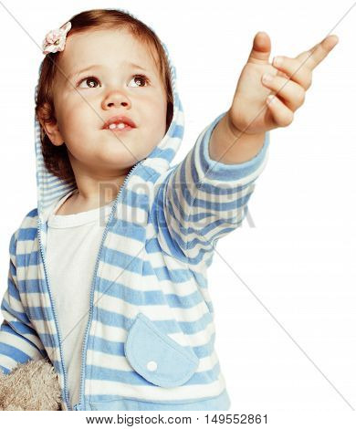 little cute adorable baby girl pointing isolated on white close up, sweet real toddler