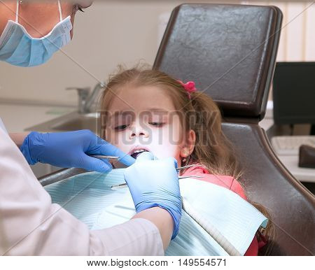 a modern dental clinic young dentist working