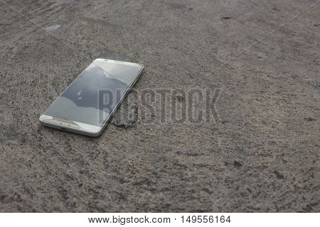 Modern mobile phone with broken screen and soft focus.