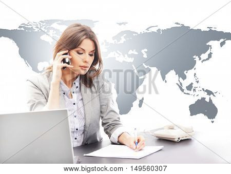 Beautiful business woman answering international calls via smartphone. Global business concept.