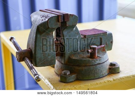 Vise tool in workshop or the garage for support hard work, Special tools for industry job, vise stand on the table with other basic tool, Hand tool on table for service and repair in industry job.