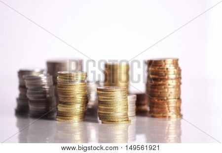 Coins stacked up  isolated on white background