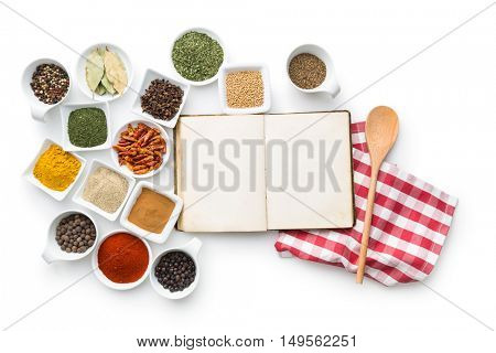 Blank cookbook and various spices isolated on white background. Top view.