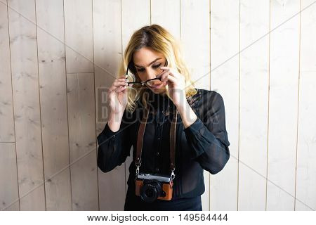 Beautiful woman wearing spectacle against texture background