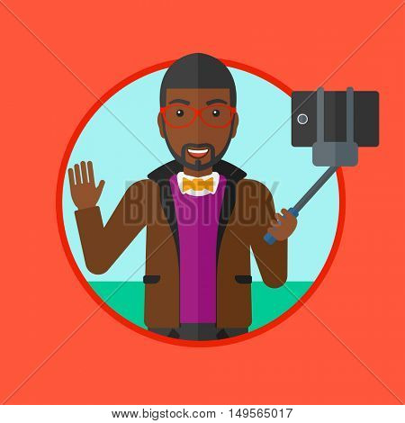 An african-american man making selfie with a selfie-stick. Man taking photo with cellphone. Young man taking selfie and waving. Vector flat design illustration in the circle isolated on background.
