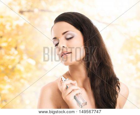 Portrait of beautiful, fresh and healthy girl over seasonal autumn background.