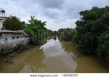 tropical river in mekong delta, vietnam countryside