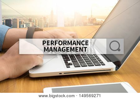 PERFORMANCE MANAGEMENT SEARCH WEBSITE INTERNET SEARCHING  business man work hard