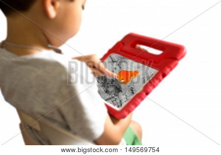 Little boy sitting in the chair playing with gold fish love and care concept