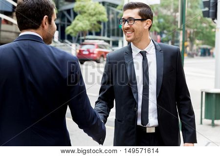 Two businessmen shaking their hands